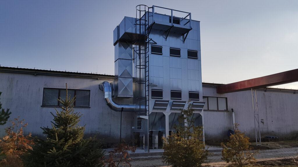 System odpylający składający się z odpylacza workowego, podciśnieniowego